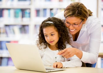 woman and child using laptop computer