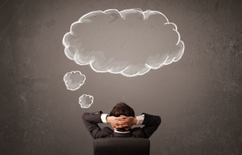 Business seated thinking of cloud