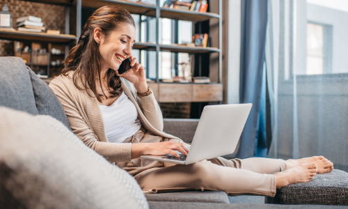 woman seated at home using laptop